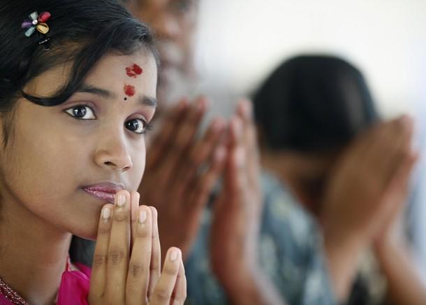 A Malaysian of Hindu faith recites a prayer during Diwali celebrations in Kuala Lumpur